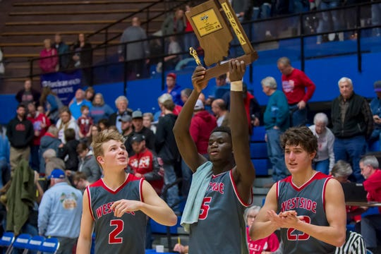 West Lafayette's Nelson Mbongo raises the sectional championship trophy after West Lafayette defeated Maconaquah at Case Arena.