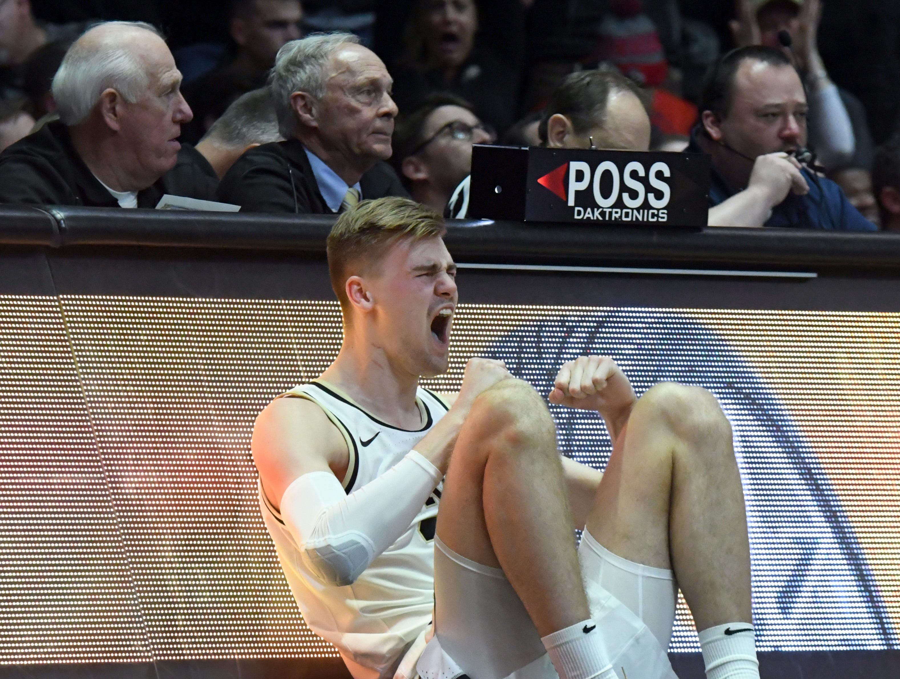 By Frank Oliver for the Journal and Courier --Purdue's Matt Haarms cheers for his team as he waits to enter the game in the first half against Ohio State on March 2, 2019 in West Lafayette. Purdue defeated the Buckeyes 86-51.