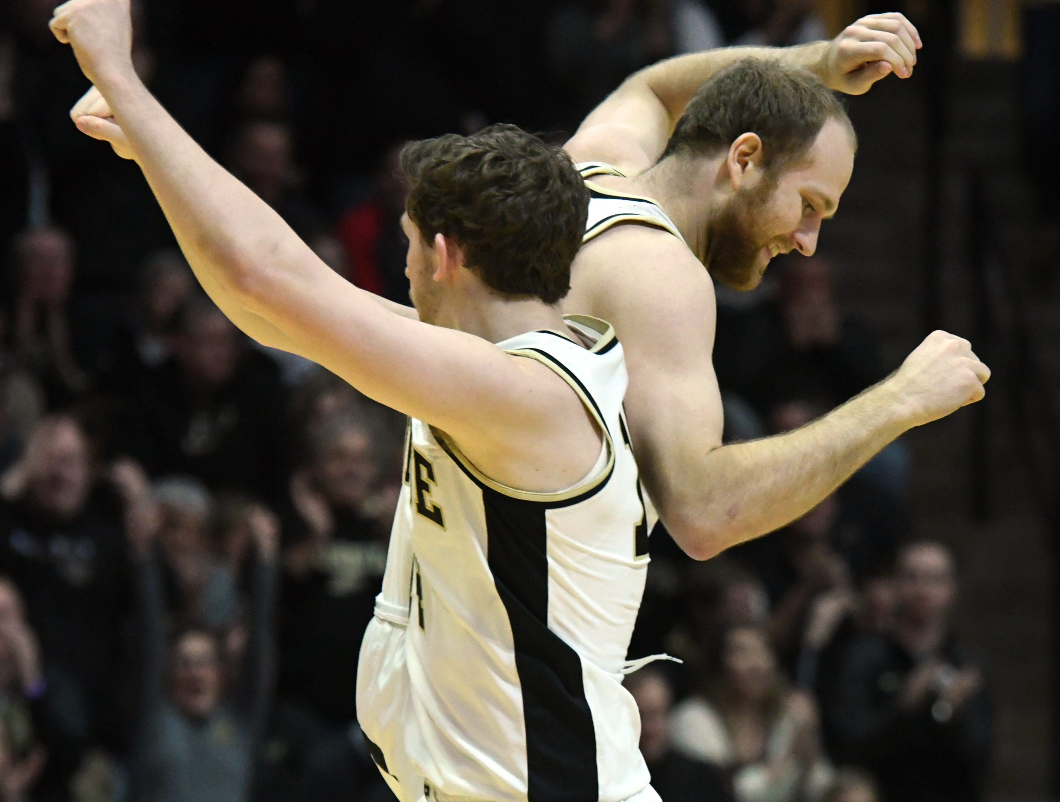 By Frank Oliver for the Journal and Courier --Purdue's Ryan Cline, left, and Evan Boudreaux celebrate after a three-point shot by Boudreaux in the first half against Ohio State on March 2, 2019 in West Lafayette.