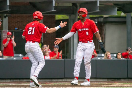 UL's Orynn Veillon (21), who homered to beat Southern Miss last week, congratulates Todd Lott (9), who went 6 for 10 over the weekend at Little Rock, during a game against Maryland earlier this season.
