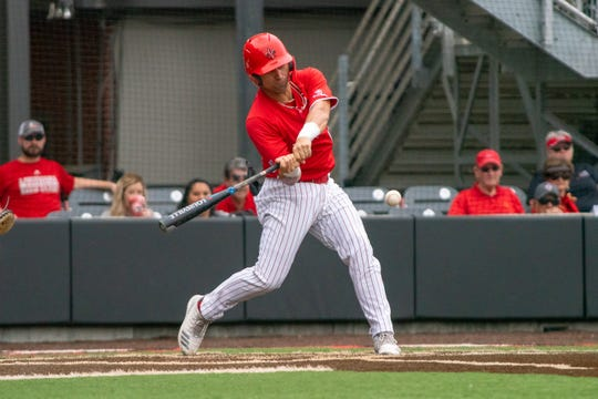 UL's Sebastian Toro connects with the pitch as the Ragin' Cajuns take on the University of Maryland Terrapins in a double-header at M.L. Tigue Moore Field on March 2, 2019.
