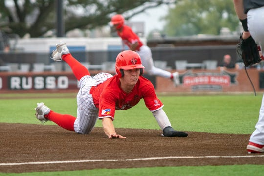 Ragin' Cajuns shortstop Hayden Cantrelle dives into third base during a doubleheader against Maryland last March.
