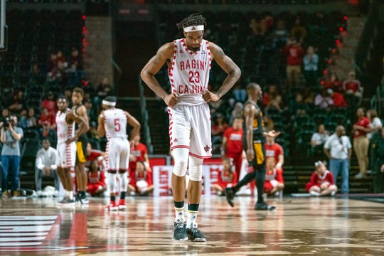 UL senior JaKeenan Gant walks off the Cajundome floor, perhaps for the last time, after fouling out off a loss to Appalachian State on Sunday.