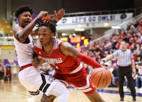 Jeff's Tre Coleman tries to muscle past New Albany's Derrick Stevenson during the Red Devils win over New Albany 60-42 in the Seymour Sectional Saturday, March 2, 2019.