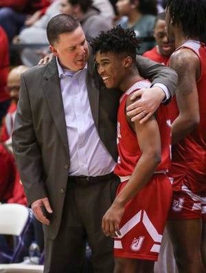 Jeff coach Joe Luce hugged player Darin Starks as the Red Devils beat New Albany at the Seymour Sectional Saturday, March 2, 2019. Starks used to play at New Albany High School before transferring to Jeff.