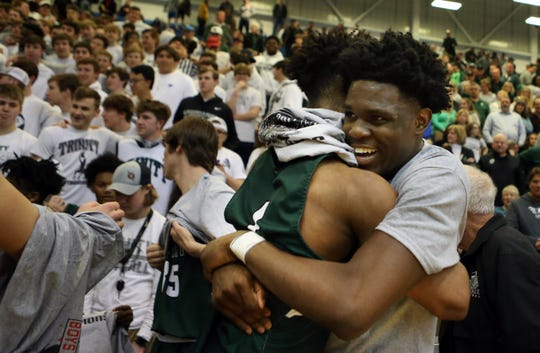 Trinity's Jamil Hardaway, right, and Kolton Rice celebrate the Shamrocks winning the 7th Region Championship. 