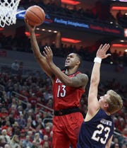Louisville's V.J. King gets by Notre Dame's Dane Goodwin for the bucket. March 3, 2019