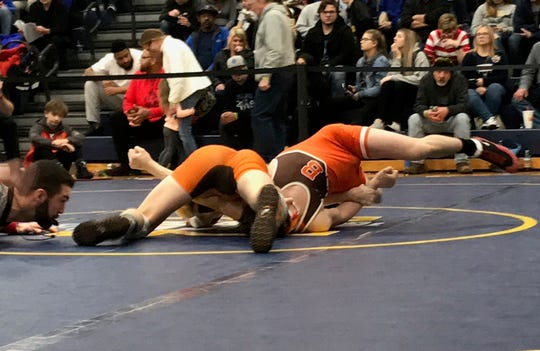 Mansfield Senior's Josh Lyons pins Buckeye's Anthony Ashley for third place at 126 pounds in the Division II district tournament at Norwalk.