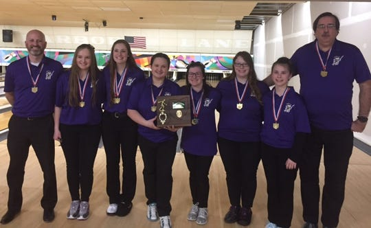 The Lexington girls bowling team shows off its hardware after winning a district championship Saturday at Star Lanes in Port Clinton.