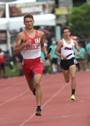Shelby's Blake Lucius, shown here in last year's state outdoor track meet, joined teammates Caleb Brown and Sam Logan as a indoor state champ in two events.