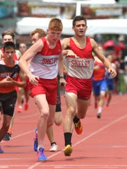 Shelby's Caleb Brown (left) and Sam Logan, shown here competing in last spring's state outdoor track meet, each won two indoor state crowns Saturday. Brown shattered the DII-III meet record in the 3200.