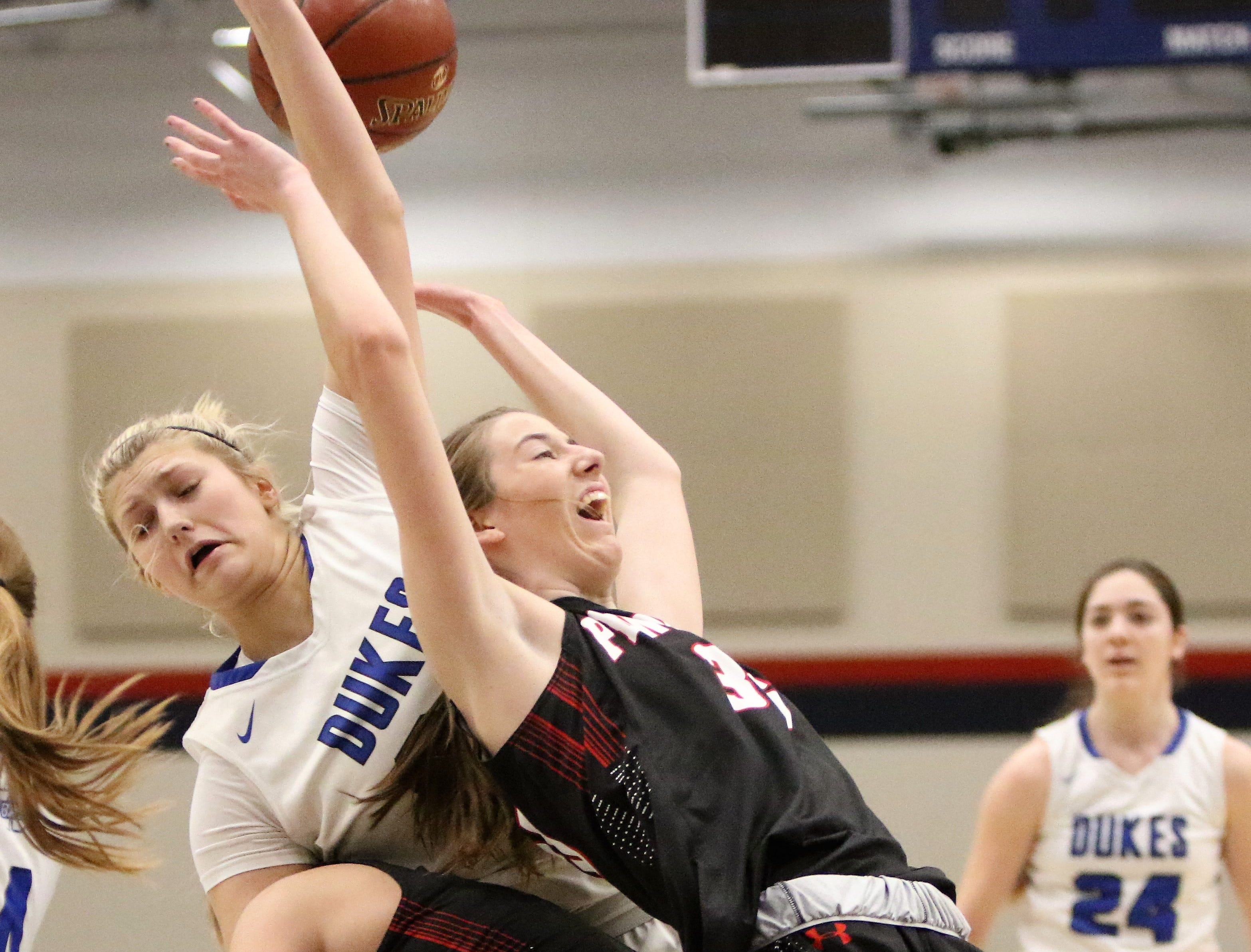 Whitefish Bay forward Ava Alt (middle) goes down with a pair of Pewaukee players while battling for a rebound during a sectional final game on March 2, 2019.