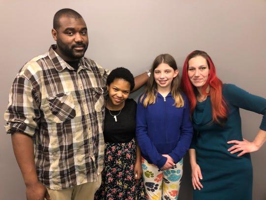 Jerome Johnson, Esperanza Luke, Lauren Baas support runner Lyrique Jackson, second from left, at the Girls on the Run fundraiser.
