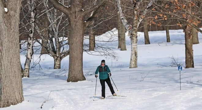 Three days into meteorological spring, 13 degree temperatures and wind did not stop Kim Baker of Milwaukee from enjoying the cross country ski trails at Brown Deer Park on Sunday.