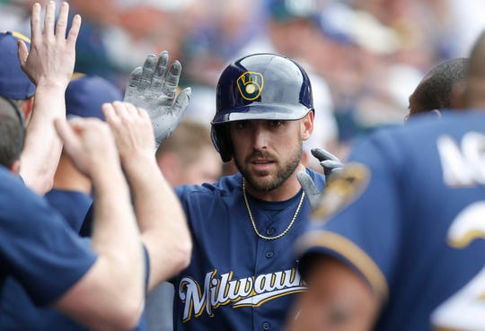 Brewers second baseman Travis Shaw celebrates with teammates after hitting a two-run home run against the Chicago Cubs in the first inning Saturday at Sloan Park.
