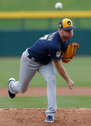 Brewers starting pitcher Chase Anderson delivers a pitch against the Cubs in the first inning. Anderson tossed three scoreless innings Saturday, allowing just one hit and one walk while striking out three.