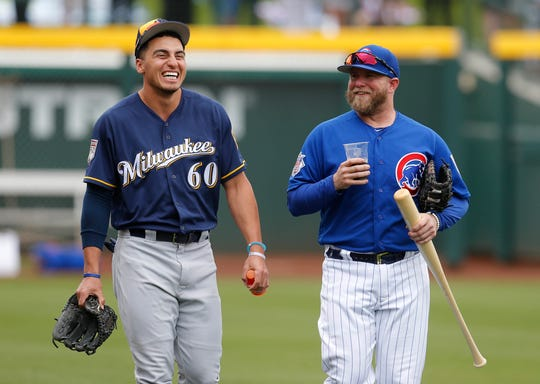 Brewers outfield prospect Tyrone Taylor shares a few laughs with Cubs catcher Taylor Davis before the team's squared off Saturday.