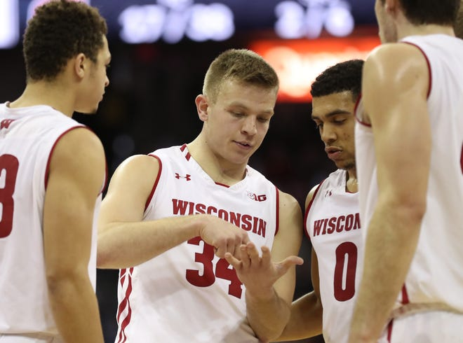 UW guard Brad Davison rallied his teammates when assistant coach Howard Moore suffered a heart attack and implored them to get to the gym as scheduled, the way Moore would have wanted, according to head coach Greg Gard.