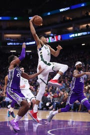 Bucks forward Giannis Antetokounmpo prepares to dunk against the Kings at the Golden 1 Center on Feb. 27.