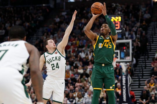 Jazz guard Donovan Mitchell launches a three-pointer against Bucks guard during the second quarter on Saturday night. Mitchell keyed Utah's fourth quarter comeback against Milwaukee as he finished with a season-high 46 points.