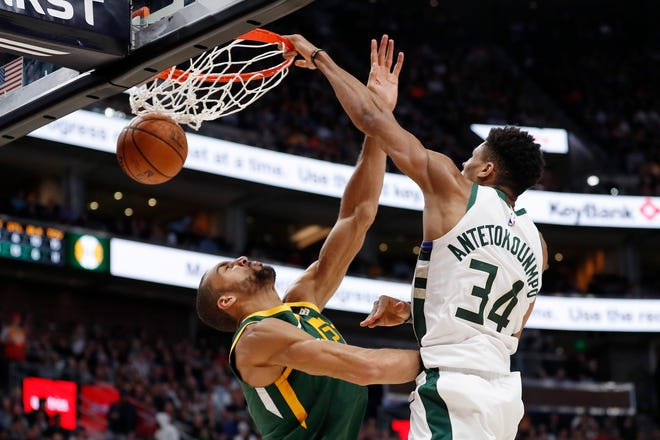 Jazz center Rudy Gobert is helpless as Bucks forward Giannis Antetokounmpo hammers home a dunk in the fourth quarter.