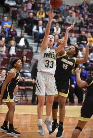 Mountain Home's Anna Grace Foreman is fouled during the Lady Bombers' 46-44 loss to Jonesboro on Saturday night.