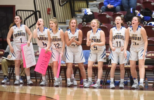 The Lady Bomber bench celebrates a momentum-swinging play on Saturday.