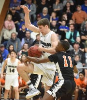 Izard County's Caleb Faulkner is fouled during the Cougars' quarterfinal game against Dermott.