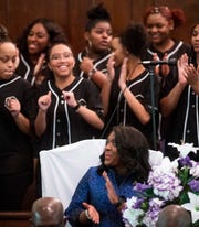 Rep. Terri Sewell listens as the African American Gospel Choir of the University of Alabama performs at Brown Chapel in Selma, Ala., on Sunday March 3, 2019. Sunday is the 54th commemoration of the 1965 Bloody Sunday bridge crossing.