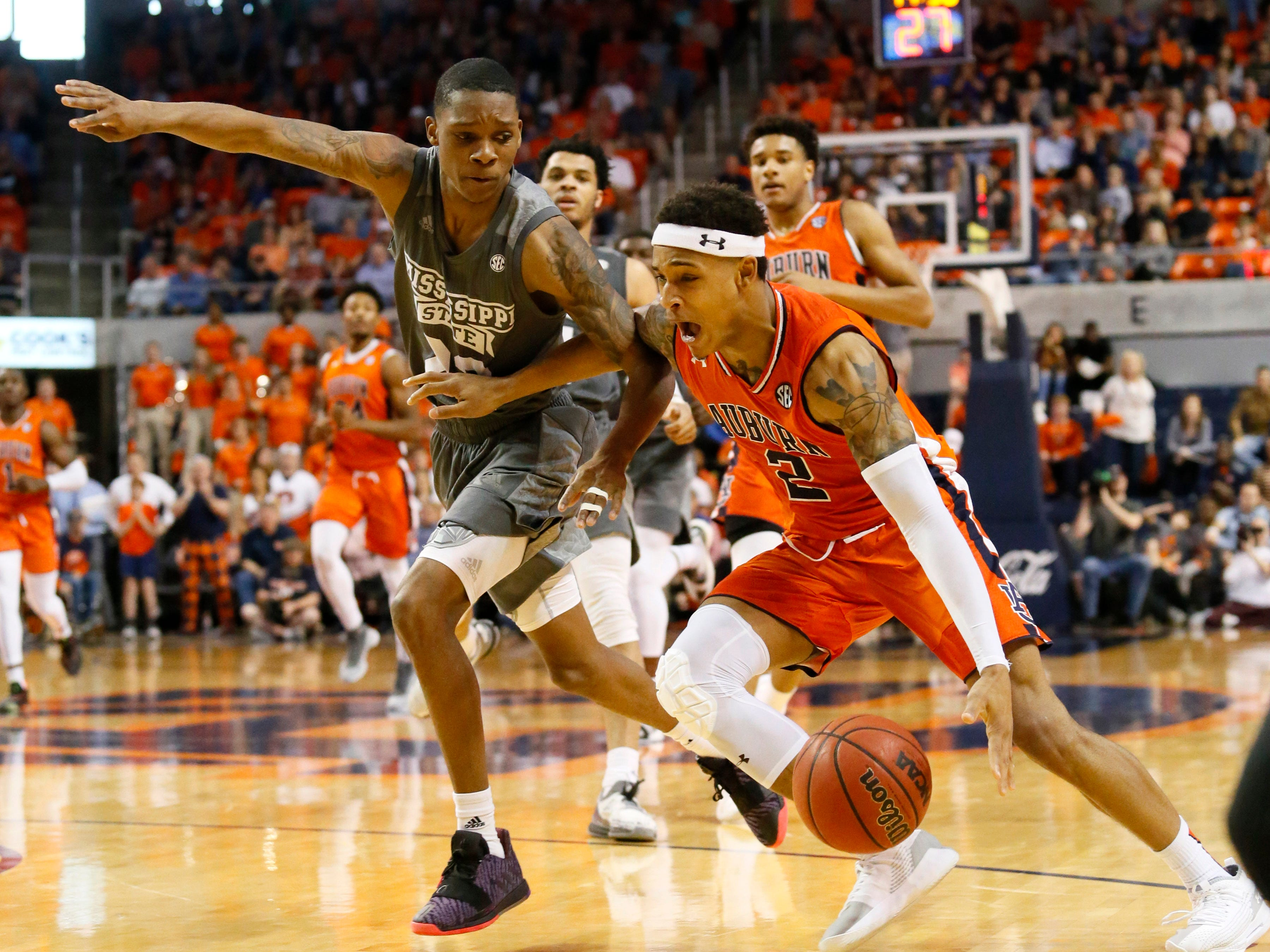 Auburn guard Bryce Brown drives past Mississippi State guard Tyson Carter (23) on Saturday, March 2, 2019, in Auburn, Ala.