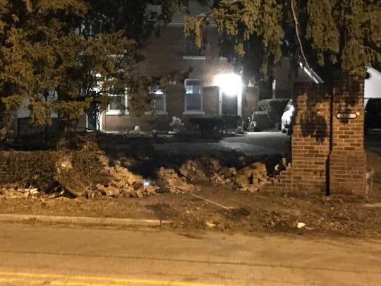 City police said a Muncie man driving a stolen van early Saturday demolished a large brick wall at the historic Otto Carmichael House along Kilgore Avenue, after also causing damage to the Delaware County jail and High Street United Methodist Church.
