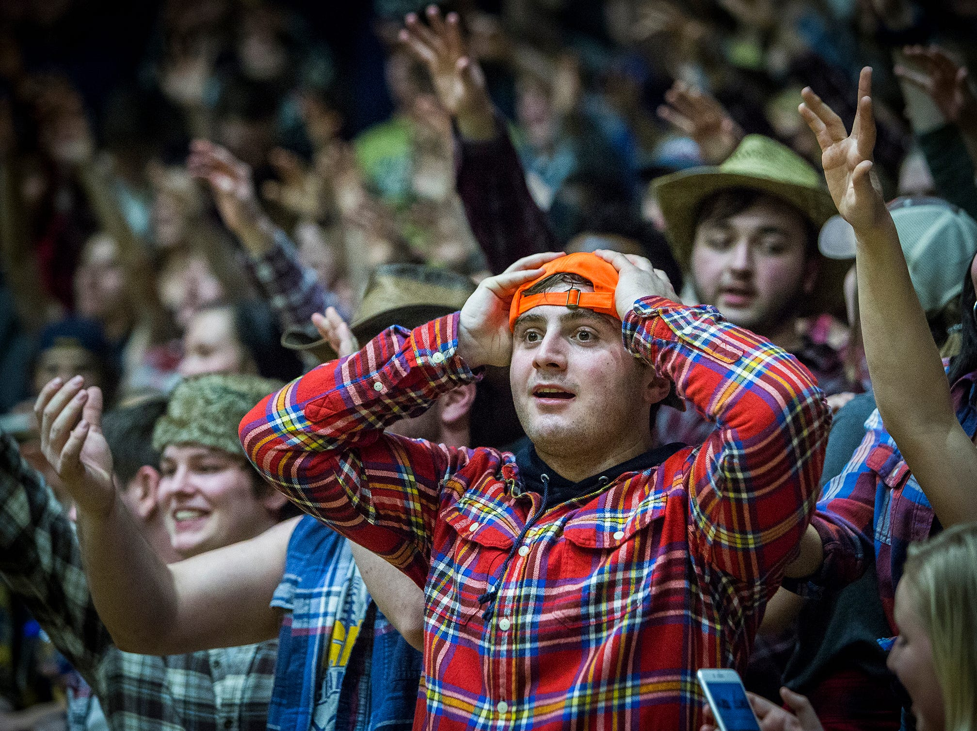 Delta fans react to their team defeating New Castle in the sectional championship game at New Castle High School Saturday, March 2, 2019.