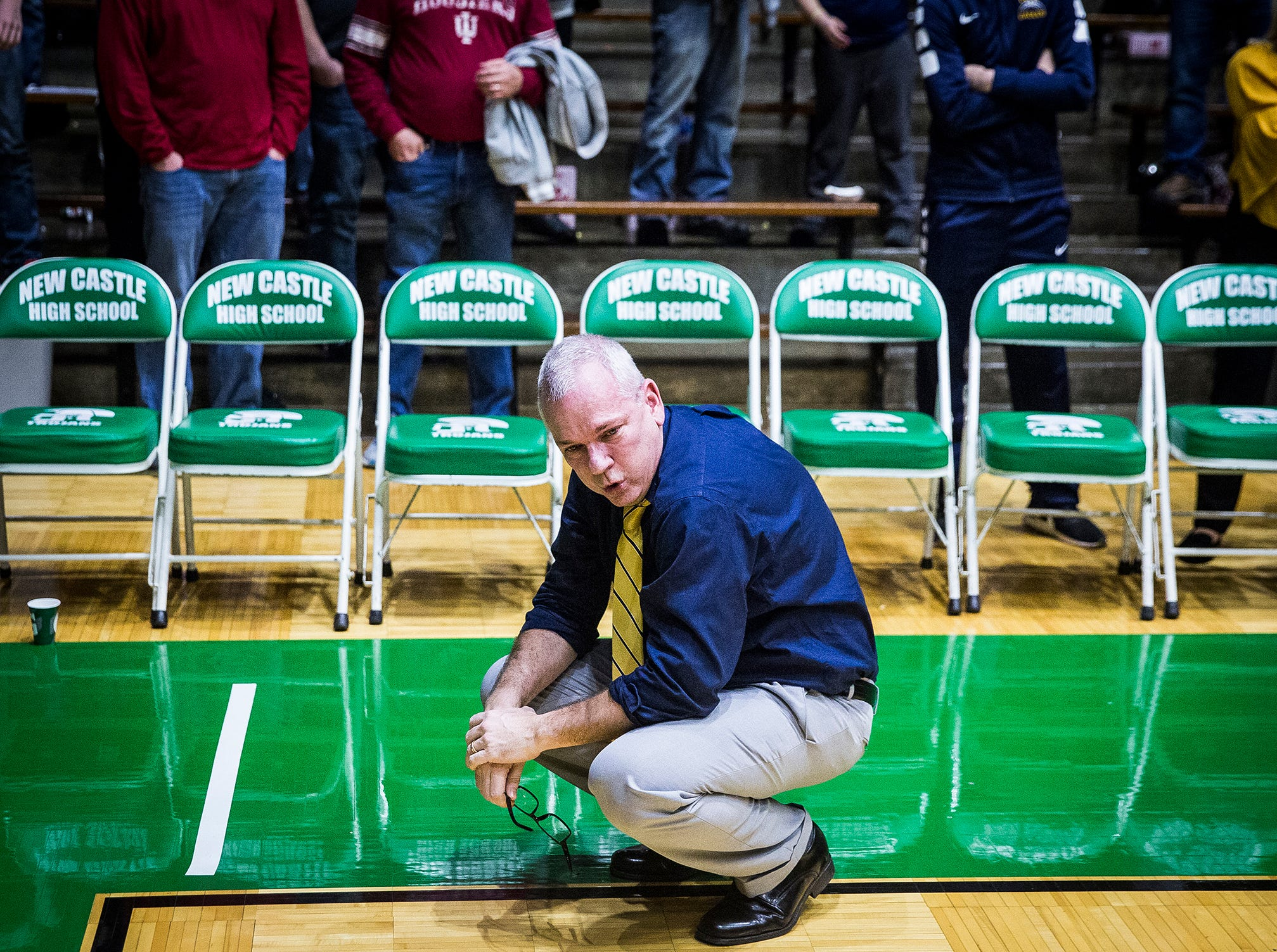 Delta head coach Mark Detweiler reacts after an narrow victory over New Castle during their sectional championship game at New Castle High School Saturday, March 2, 2019.