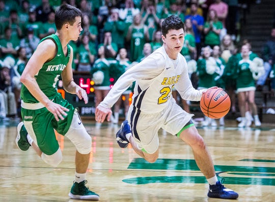 FILE -- Delta's Conner Bedwell dribbles against New Castle in their sectional championship game at New Castle High School Saturday, March 2, 2019.