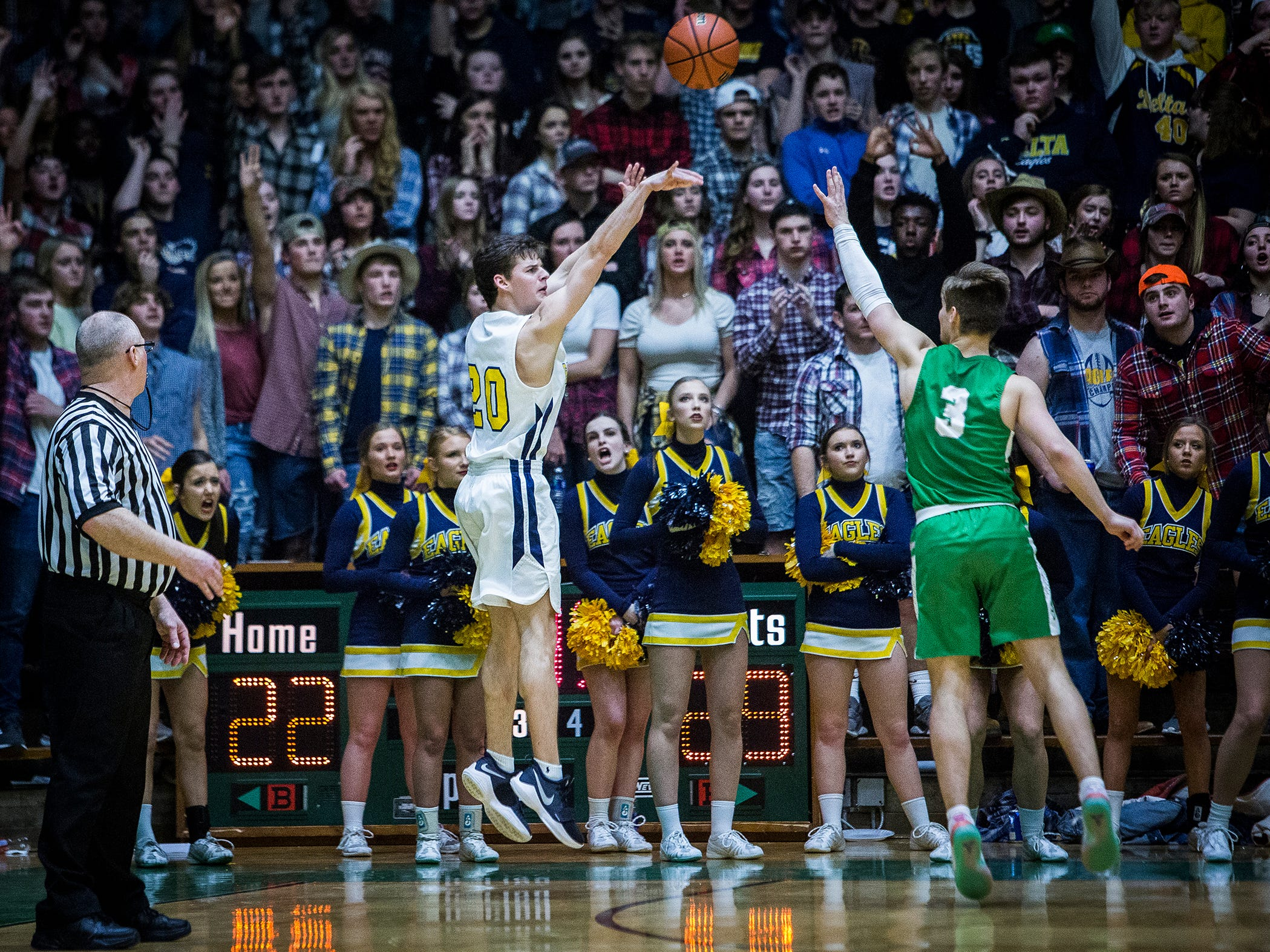 Delta's Josh Greenberg shoots against New Castle during their sectional championship game at New Castle High School Saturday, March 2, 2019.