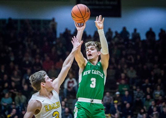 New Castle's Luke Bumbalough shoots over Delta in their sectional championship game at New Castle High School Saturday, March 2, 2019.
