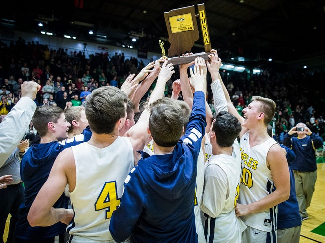 Delta celebrates defeating New Castle in their sectional championship game at New Castle High School Saturday, March 2, 2019.