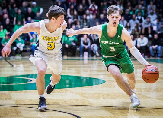 New Castle's Luke Bumbalough drives against Delta in their sectional championship game at New Castle High School Saturday, March 2, 2019.
