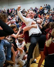 Eagleville coach Chris Lynch celebrates with fans after the Lady Eagles defeated Clay County in the Class A sectional Saturday night.