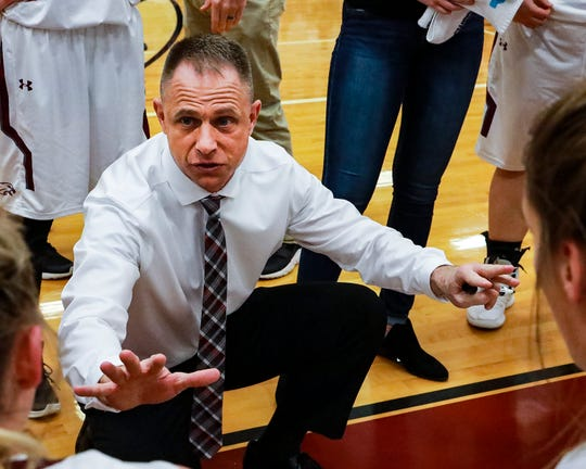 Eagleville coach Chris Lynch talks to his squad during Saturday's 47-46 Class A sectional win over Clay County.