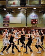 Eagleville's Makayla Moates (15) puts up the game-winning shot in Saturday's Class A sectional win over Clay County.