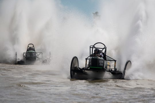Dan Greenling in Roll On takes the lead during the Swamp Buggy Races at Florida Sports Park in Naples on Sunday. Greenling went on to win the Big Feature as well as the season-long Budweiser Cup.
