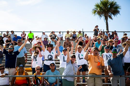 Dan Greenling's friends and family members cheer as Roll On speeds past them during the Swamp Buggy Races at Florida Sports Park in Naples on Sunday.