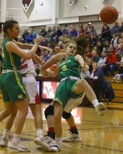 Newark Catholic sophomore Brynn Peddicord is unable to gain control of a loose ball Saturday during a Division IV district final against Fairfield Christian at New Albany. The Green Wave won 68-56.