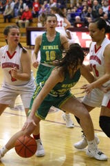 Harlei Antritt dribbles in the post against Fairfield Christian defenders during Saturday's Division IV district final at New Albany. The Green Wave won 68-56.