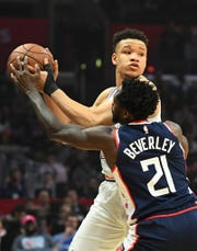 Los Angeles Clippers guard Patrick Beverley (21) defends New York Knicks forward Kevin Knox (20) in the first half of the game at Staples Center.