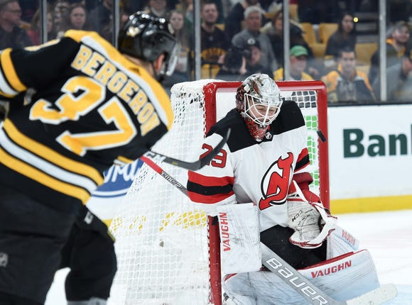Mar 2, 2019; Boston, MA, USA; Boston Bruins center Patrice Bergeron (37) shoots the puck at New Jersey Devils goaltender Mackenzie Blackwood (29) during the second period at TD Garden.