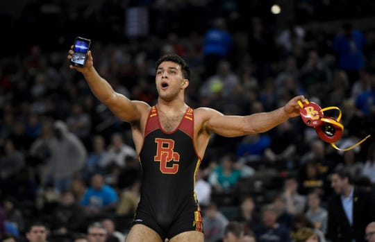 Bergen Catholic's Jacob Cardenas points his phone to the crowd after defeating Paramus' Kyle Jacob (not pictured) in the 195-pound final in the NJSIAA state wrestling tournament on Saturday, March 2, 2019, in Atlantic City.