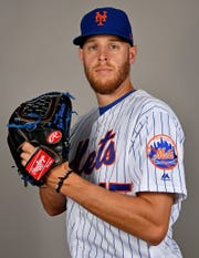 Feb 21, 2019; Port St. Lucie, FL, USA; New York Mets starting pitcher Zack Wheeler (45) poses for a photo on photo day at First Data Field.