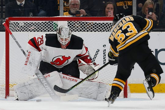 Boston Bruins' Brad Marchand (63) misses a penalty shot on New Jersey Devils' Mackenzie Blackwood (29) during the first period of an NHL hockey game in Boston, Saturday, March 2, 2019.